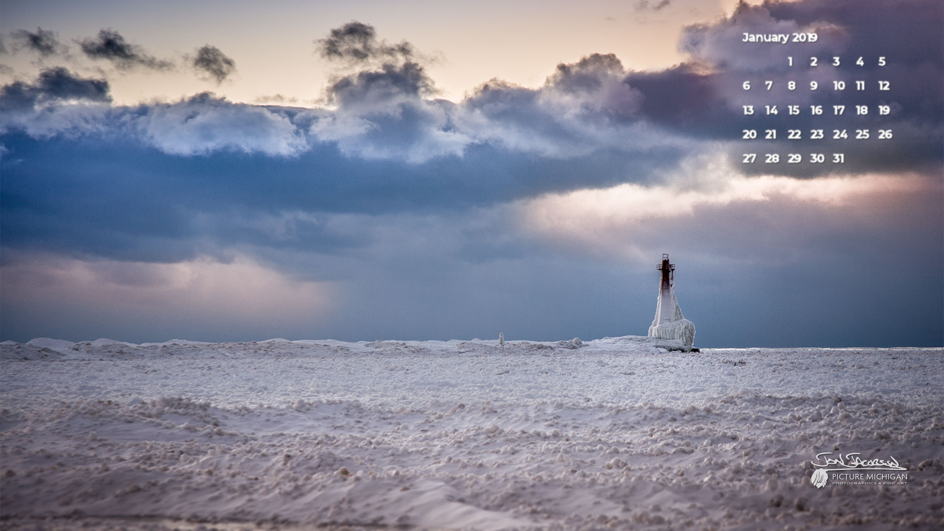 Winter scene of Muskegon South Break Light